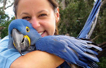 aviculturist with macaw